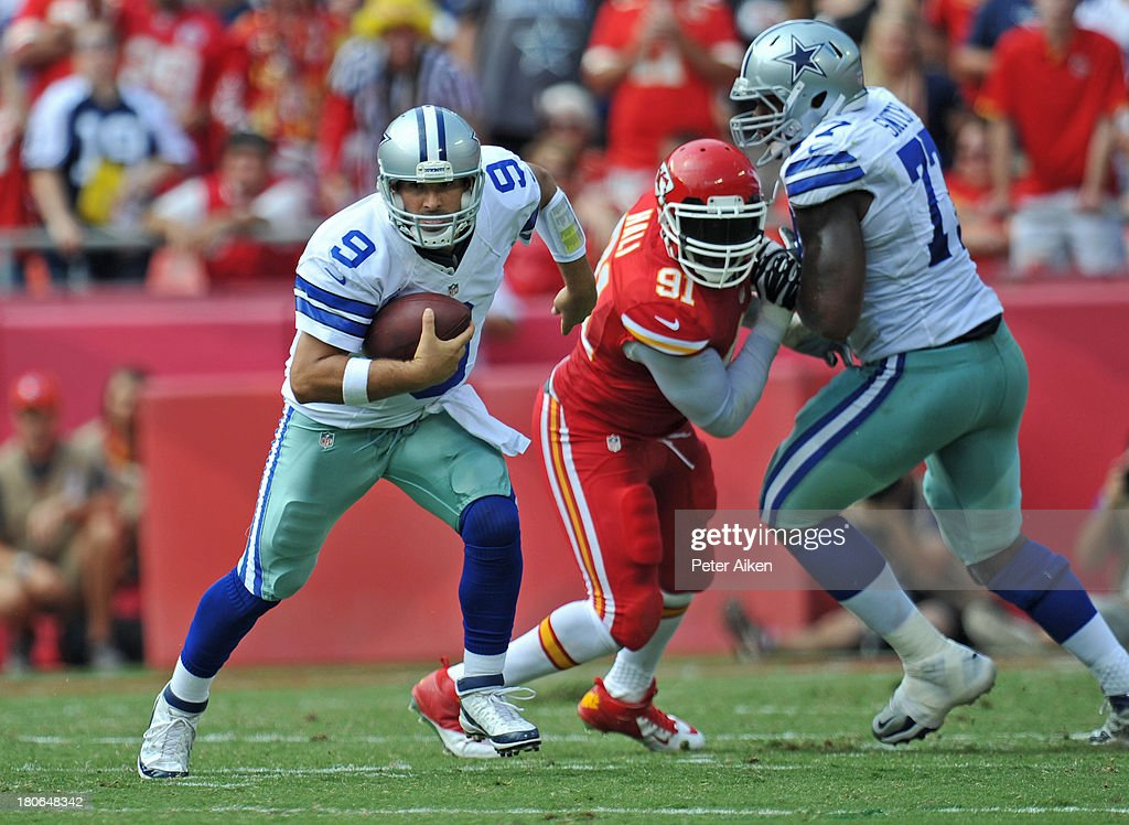 Quarterback <a gi-track='captionPersonalityLinkClicked' href=/galleries/search?phrase=Tony+Romo&family=editorial&specificpeople=756503 ng-click='$event.stopPropagation()'>Tony Romo</a> #9 of the Dallas Cowboys rushes up field past linebacker <a gi-track='captionPersonalityLinkClicked' href=/galleries/search?phrase=Tamba+Hali&family=editorial&specificpeople=630576 ng-click='$event.stopPropagation()'>Tamba Hali</a> #91 of the Kansas City Chiefs during the second half on September 15, 2013 at Arrowhead Stadium in Kansas City, Missouri. Kansas City defeated Dallas 17-16.