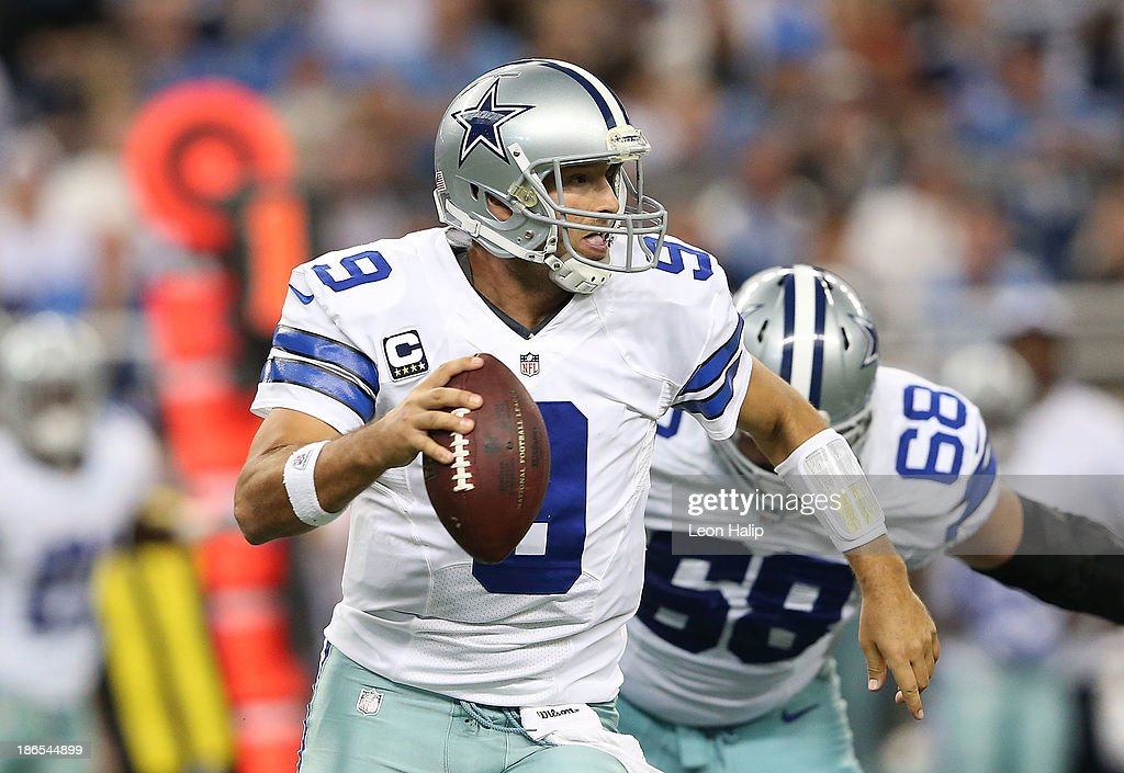 Quarterback Tony Romo #9 of the Dallas Cowboys scrambles for a short gain during the first quarter of the game against the Detroit Lions at Ford Field on October 27, 2013 in Detroit, Michigan. The Lions defeated the Cowboys 31-30.