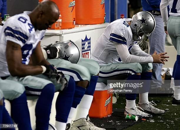 Quarterback Tony Romo of the Dallas Cowboys sits dejected after fumbling the field goal snap in the fourth quarter of the NFC Wild Card Playoff Game...