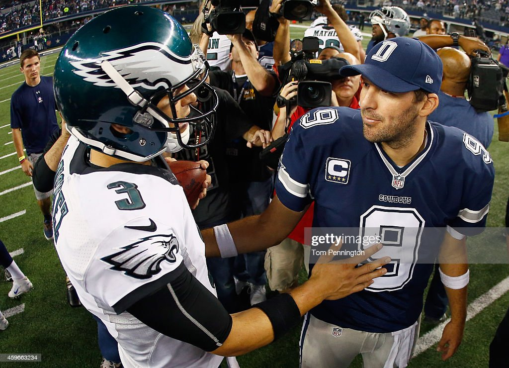 Quarterback <a gi-track='captionPersonalityLinkClicked' href=/galleries/search?phrase=Tony+Romo&family=editorial&specificpeople=756503 ng-click='$event.stopPropagation()'>Tony Romo</a> #9 of the Dallas Cowboys talks with quarterback <a gi-track='captionPersonalityLinkClicked' href=/galleries/search?phrase=Mark+Sanchez&family=editorial&specificpeople=690406 ng-click='$event.stopPropagation()'>Mark Sanchez</a> #3 of the Philadelphia Eagles after the Eagles beat the Cowboys 33-10 at AT&T Stadium on November 27, 2014 in Arlington, Texas.