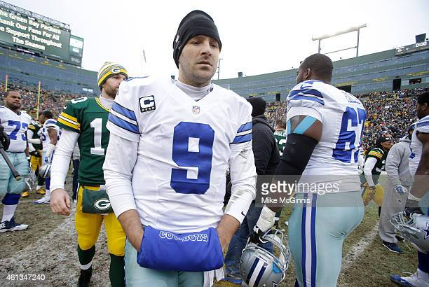 Quarterback Tony Romo of the Dallas Cowboys walks off the field after the Green Bay Packers won 2621 during the 2015 NFC Divisional Playoff game at...