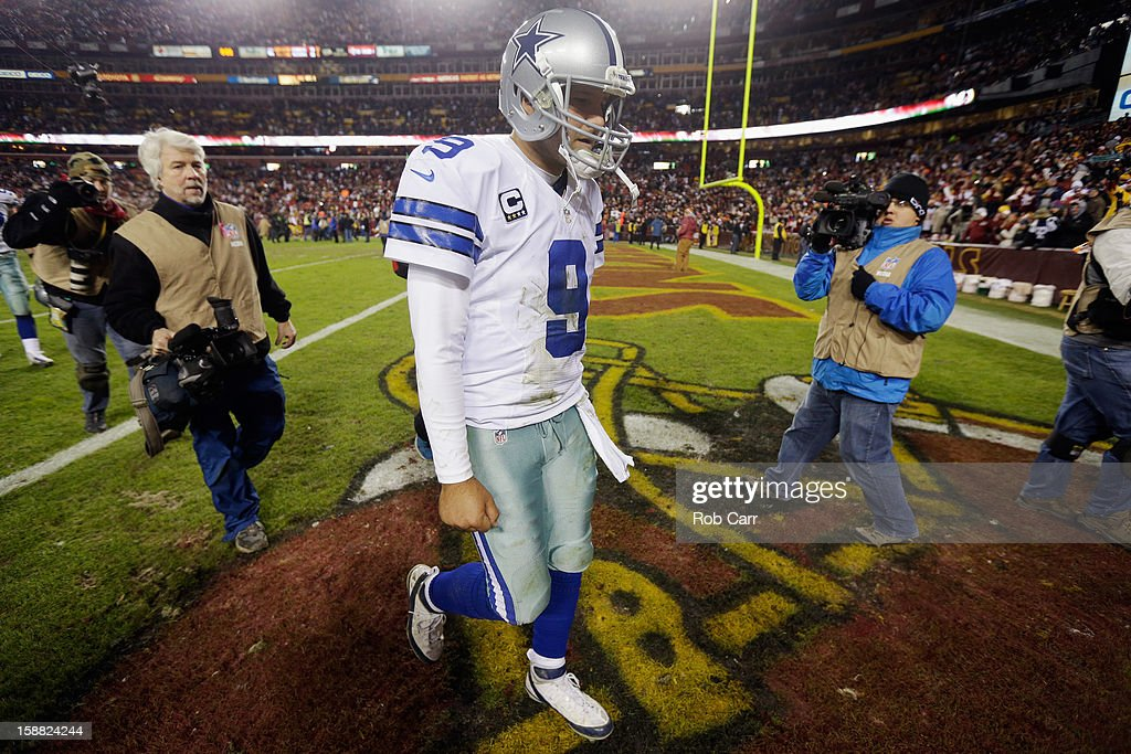 Quarterback <a gi-track='captionPersonalityLinkClicked' href=/galleries/search?phrase=Tony+Romo&family=editorial&specificpeople=756503 ng-click='$event.stopPropagation()'>Tony Romo</a> #9 of the Dallas Cowboys walks off the field following the Cowboys 28-18 loss to the Washington Redskins at FedExField on December 30, 2012 in Landover, Maryland.