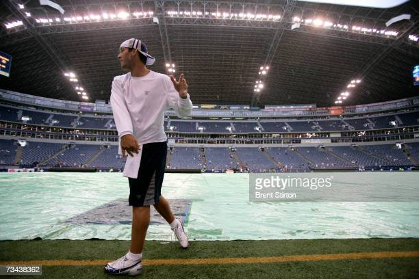 Quarterback Tony Romo of the Dallas Cowboys warms up before play against the Washington Redskins at Texas Stadium in Dallas Texas on September 17...