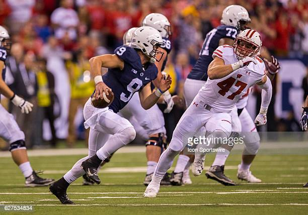 Quarterback Trace McSorley of the Penn State Nittany Lions scrambles out of the pocket in an attempt to elude linebacker Vince Biegel of the...