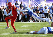 Quarterback Travis Wilson of the Utah Utes runs for a touchdown against defensive back Micah Hannemann of the Brigham Young Cougars during the Royal...