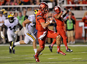 Quarterback Travis Wilson of the Utah Utes runs for this 3rd quarter touchdown against the Michigan Wolverines at RiceEccles Stadium on September 3...