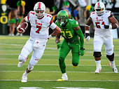 Quarterback Travis Wilson of the Utah Utes runs with the ball during the first quarter of the game against the Oregon Ducks at Autzen Stadium on...