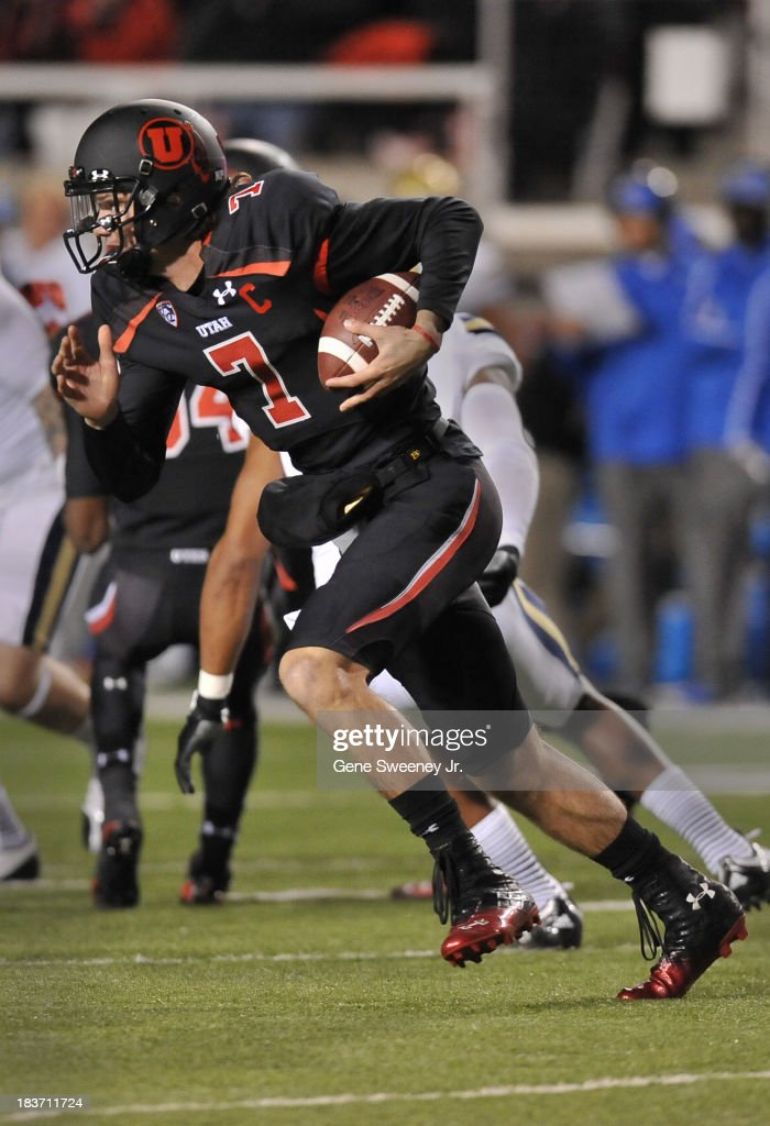 Quarterback <a gi-track='captionPersonalityLinkClicked' href=/galleries/search?phrase=Travis+Wilson+-+American+Football+Quarterback&family=editorial&specificpeople=15147363 ng-click='$event.stopPropagation()'>Travis Wilson</a> #7 of Utah runs a keeper during their game against UCLA at Rice- Eccles Stadium October 3, 2013 in Salt Lake City, Utah.