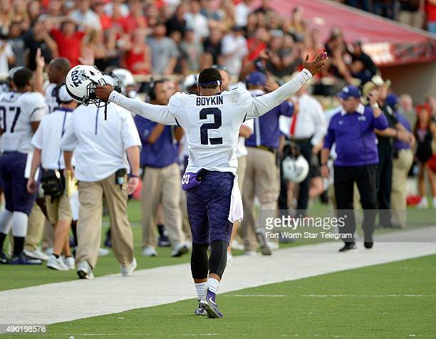 TCU quarterback Trevone Boykin celebrates the a twopoint conversion after a touchdown against Texas Tech at Jones ATT Stadium in Lubbock Texas on...