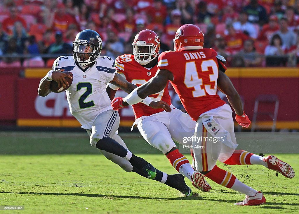 Quarterback Trevone Boykin #2 of the Seattle Seahawks rushes up field against safety Akeem Davis #43 of the Kansas City Chiefs during the second half on August 13, 2016 at Arrowhead Stadium in Kansas City, Missouri.