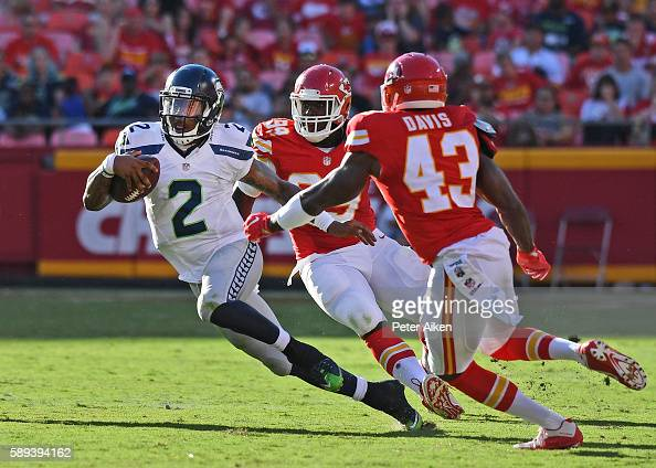 Quarterback Trevone Boykin of the Seattle Seahawks rushes up field against safety Akeem Davis of the Kansas City Chiefs during the second half on...