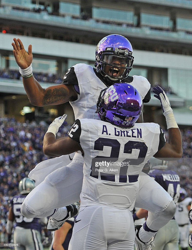 Quarterback Trevone Boykin #2 of the TCU Horned Frogs celebrates with teammate Aaron Green #22 after scoring a touchdown against the Kansas State Wildcats during the second half on November 16, 2013 at Bill Snyder Family Stadium in Manhattan, Kansas. Kansas State defeated TCU 33-31.