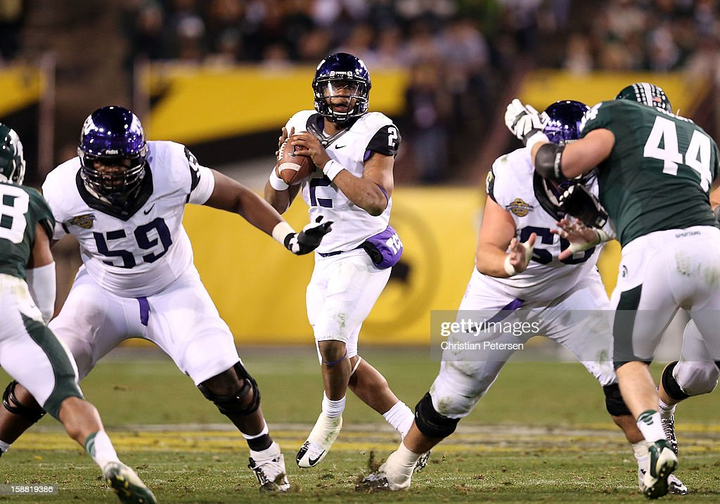 Quarterback Trevone Boykin #2 of the TCU Horned Frogs drops back to pass during the Buffalo Wild Wings Bowl against the Michigan State Spartans at Sun Devil Stadium on December 29, 2012 in Tempe, Arizona. The Spartans defeated the Horned Frogs 17-16.