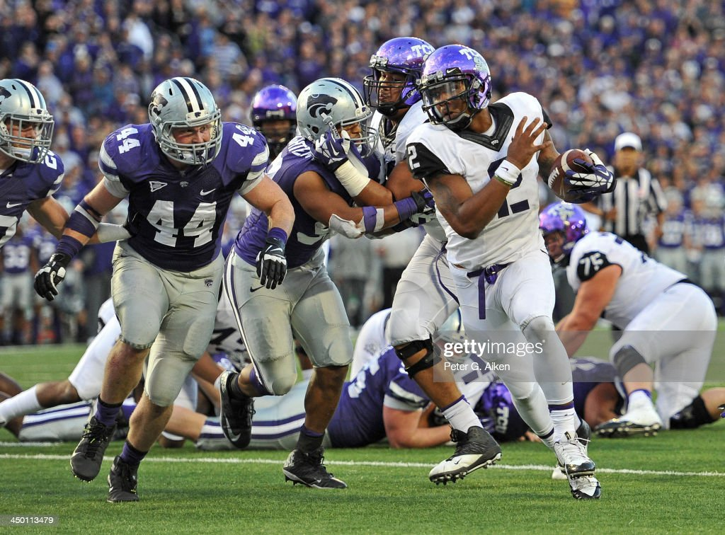 Quarterback Trevone Boykin #2 of the TCU Horned Frogs rushes in for a seven yard touchdown past defensive end Ryan Mueller #44 of the Kansas State Wildcats during the second half on November 16, 2013 at Bill Snyder Family Stadium in Manhattan, Kansas. Kansas State defeated TCU 33-31.