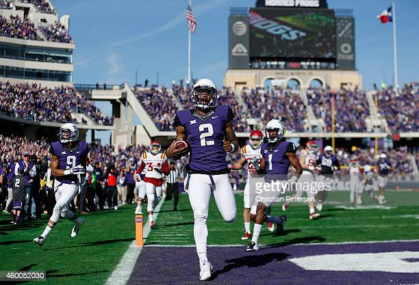 Quarterback Trevone Boykin of the TCU Horned Frogs scores on a 55 yard touchdown reception against the Iowa State Cyclones during the first quarter...