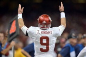 Quarterback Trevor Knight of the Oklahoma Sooners celebrates a touchdown pass in the fourth quarter against the Alabama Crimson Tide during their win...