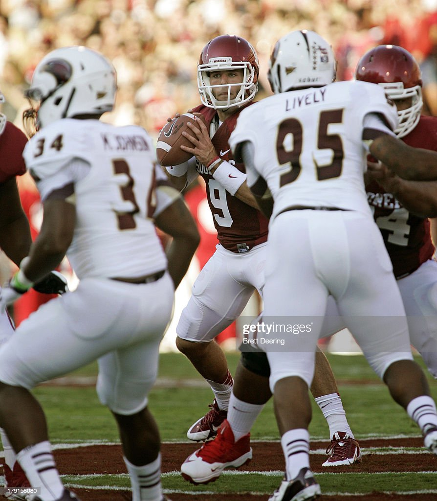 Quarterback <a gi-track='captionPersonalityLinkClicked' href=/galleries/search?phrase=Trevor+Knight&family=editorial&specificpeople=10964962 ng-click='$event.stopPropagation()'>Trevor Knight</a> #9 of the Oklahoma Sooners looks to throw against the Louisiana-Monroe Warhawks August 31, 2013 at Gaylord Family-Oklahoma Memorial Stadium in Norman, Oklahoma.