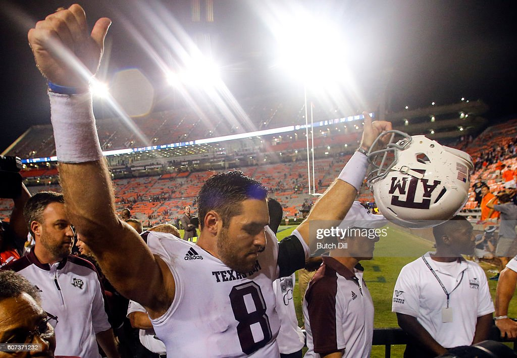 Quarterback Trevor Knight #8 of the Texas A&M Aggies celebrates as he walks off the field after they defeated the Auburn Tigers 29-16 in an NCAA college football game on September 17, 2016 in Auburn, Alabama.