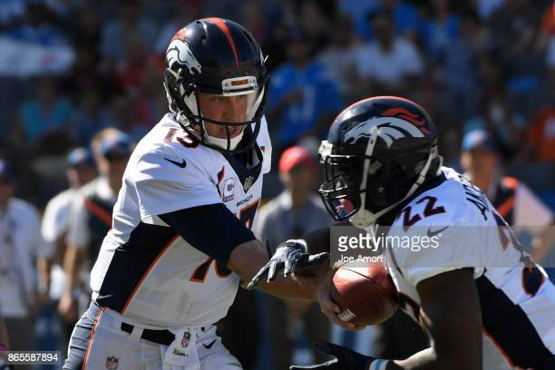 Quarterback Trevor Siemian handing off to running back CJ Anderson of the Denver Broncos as the Denver Broncos take on the Los Angeles Chargers at...