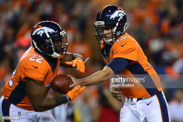 Quarterback Trevor Siemian hands the ball off to CJ Anderson of the Denver Broncos at Sports Authority Field at Mile High on September 11 2017 in...