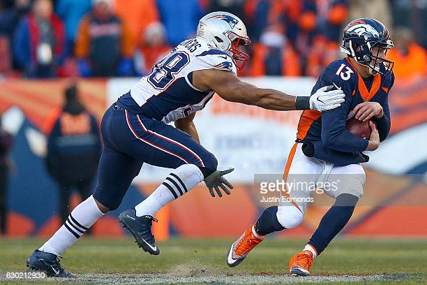 Quarterback Trevor Siemian of the Denver Broncos attempts to avoid a tackle by defensive end Trey Flowers of the New England Patriots in the second...