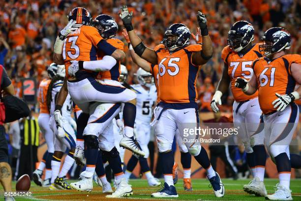 Quarterback Trevor Siemian of the Denver Broncos celebrates a touchdown with Garett Bolles in the second quarter of the game against the Los Angeles...