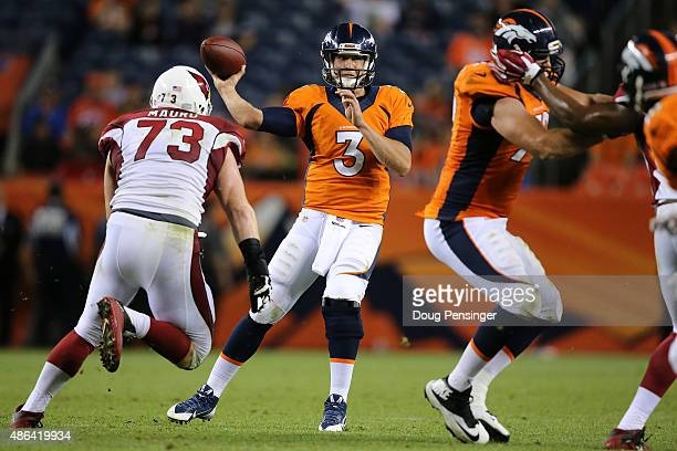 Quarterback Trevor Siemian of the Denver Broncos delivers a pass against the Arizona Cardinals during preseason action at Sports Authority Field at...