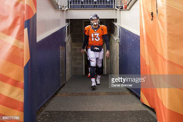 Quarterback Trevor Siemian of the Denver Broncos exits the tunnels and on to the field before the game against the Oakland Raiders at Sports...