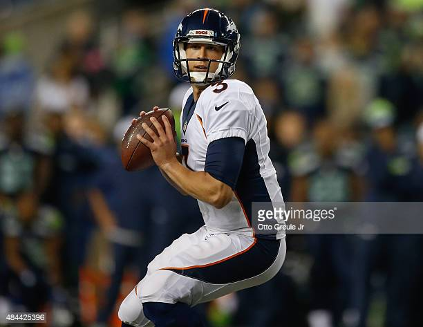 Quarterback Trevor Siemian of the Denver Broncos in action against the Seattle Seahawks at CenturyLink Field on August 14 2015 in Seattle Washington