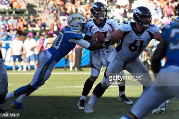 Quarterback Trevor Siemian of the Denver Broncos is sacked by defensive end Chris McCain of the Los Angeles Chargers to make it 4th and 26 as the...