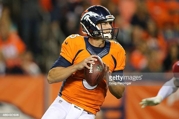 Quarterback Trevor Siemian of the Denver Broncos looks for a receiver against the Arizona Cardinals during preseason action at Sports Authority Field...