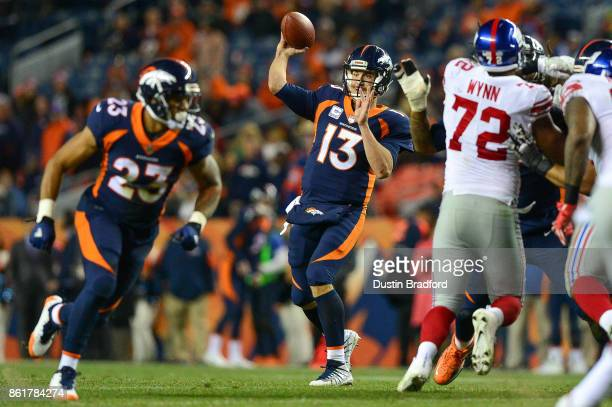 Quarterback Trevor Siemian of the Denver Broncos passes against the New York Giants in the fourth quarter of a game at Sports Authority Field at Mile...