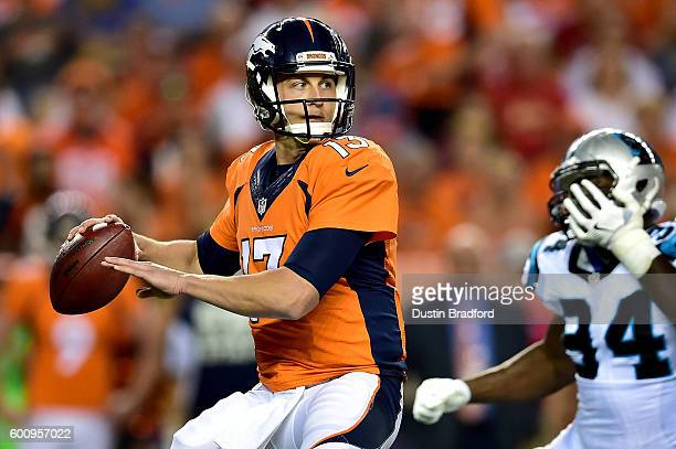 Quarterback Trevor Siemian of the Denver Broncos passes the ball in the third quarter against the Carolina Panthers at Sports Authority Field at Mile...