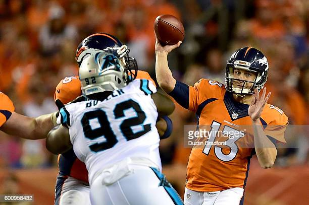 Quarterback Trevor Siemian of the Denver Broncos passes the ball against the Carolina Panthers in the second half at Sports Authority Field at Mile...