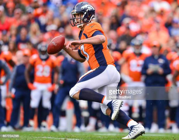 Quarterback Trevor Siemian of the Denver Broncos scrambles against the Oakland Raiders in the first quarter of a game at Sports Authority Field at...