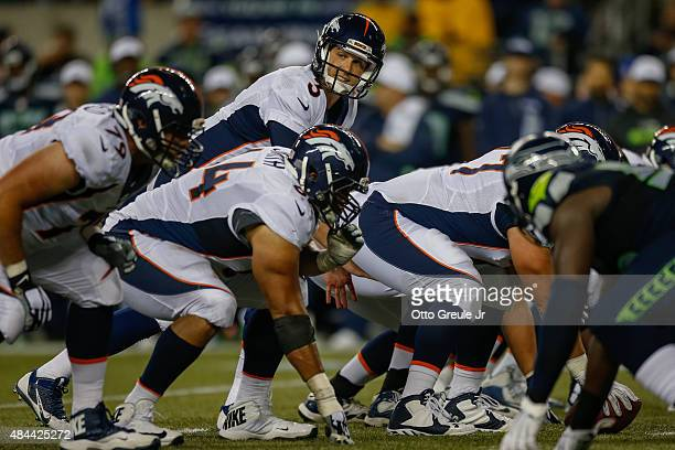 Quarterback Trevor Siemian of the Denver Broncos stands under center against the Seattle Seahawks at CenturyLink Field on August 14 2015 in Seattle...