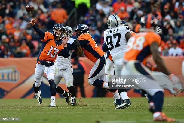 Quarterback Trevor Siemian of the Denver Broncos throws a completion to wide receiver Demaryius Thomas in the third quarter of the game at Sports...