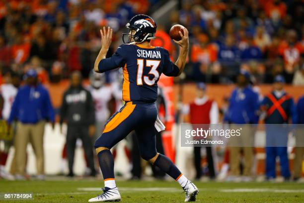 Quarterback Trevor Siemian of the Denver Broncos throws a pass during the second quarter against the New York Giants at Sports Authority Field at...