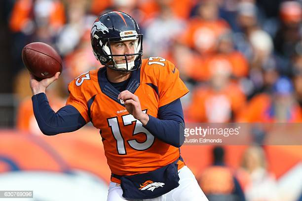 Quarterback Trevor Siemian of the Denver Broncos throws a pass in the first quarter of the game against the Oakland Raiders at Sports Authority Field...