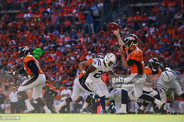 Quarterback Trevor Siemian of the Denver Broncos throws for a completion in the third quarter of the game against the Indianapolis Colts at Sports...