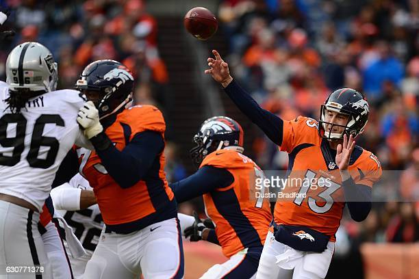 Quarterback Trevor Siemian of the Denver Broncos throws in the first half of the game against the Oakland Raiders at Sports Authority Field at Mile...