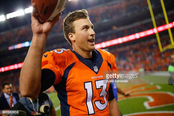Quarterback Trevor Siemian of the Denver Broncos walks off the field after defeating the Carolina Panthers 2120 at Sports Authority Field at Mile...