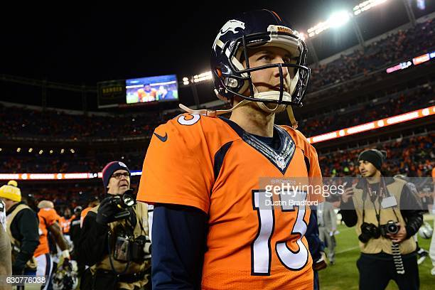 Quarterback Trevor Siemian of the Denver Broncos walks off the field after defeating the Oakland Raiders 246 at Sports Authority Field at Mile High...