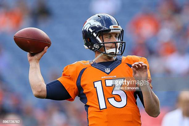Quarterback Trevor Siemian of the Denver Broncos warms up before a game against the Los Angeles Rams at Sports Authority Field at Mile High on August...
