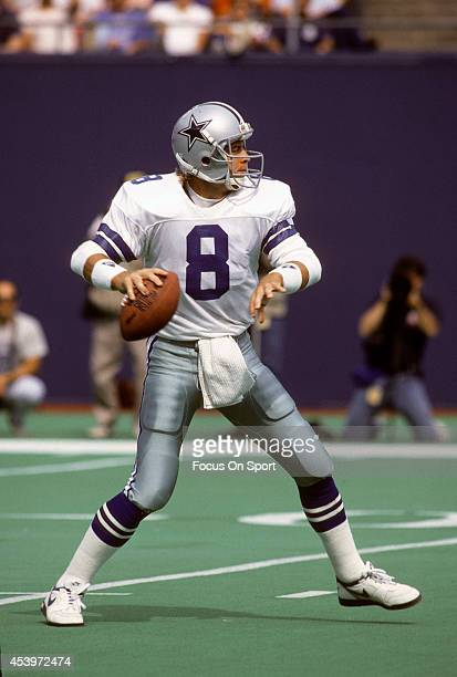 Quarterback Troy Aikam of the Dallas Cowboys drops back to pass against the New York Giants during an NFL football game September 30 1990 at Giants...