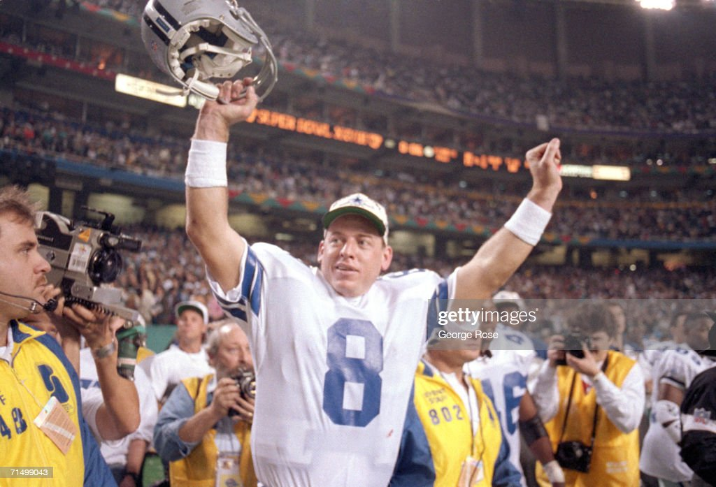 Quarterback Troy Aikman of the Dallas Cowboys celebrates their victory over the Buffalo Bills in Super Bowl XXVIII at the Georgia Dome on January 30...