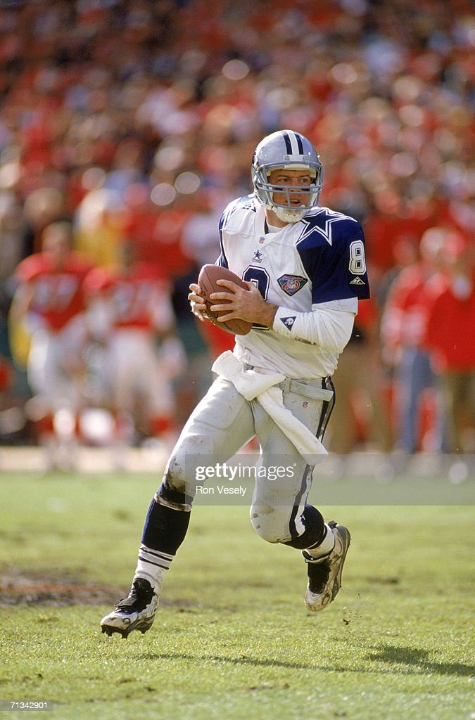 Quarterback <a gi-track='captionPersonalityLinkClicked' href=/galleries/search?phrase=Troy+Aikman&family=editorial&specificpeople=206871 ng-click='$event.stopPropagation()'>Troy Aikman</a> #8 of the Dallas Cowboys rolls out against the San Francisco 49ers during the 1994 NFC Championship at Candlestick Park on January 15, 1995 in San Francisco, California. The Niners defeated the Cowboys 38-28.