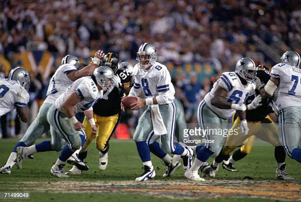 Quarterback Troy Aikman of the Dallas Cowboys runs a play during Super Bowl XXX against the Pittsburgh Steelers at Sun Devil Stadium on January 28...