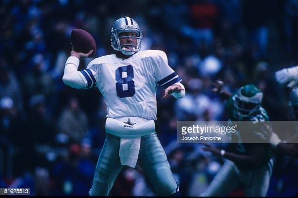 Quarterback Troy Aikman of the Dallas Cowboys sets up to pass against the Philadelphia Eagles at Texas Stadium in the 1995 NFC Divisional Playoff...