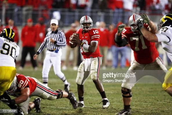 Quarterback Troy Smith of the Ohio State Buckeyes looks for a receiver against the Michigan Wolverines on November 18 2006 at Ohio Stadium in...